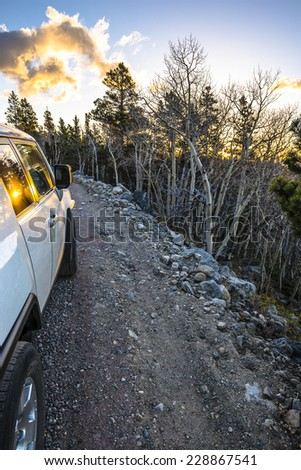 Off road vehicle on a rocky road in colorado rockies - stock photo