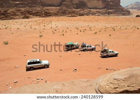Off road vehicles driving in the wadi rum desert from jordan - stock photo