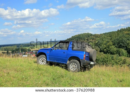 Off-road. 4x4 jeep at the top of a hill - stock photo