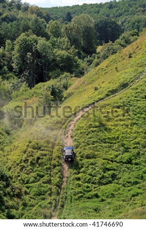 Off-road. 4x4 jeep tries to climb up top of a hill - stock photo