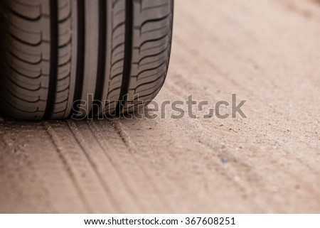 Off road 4X4 wheel tracks on country desert beach road sand motoring background image - stock photo