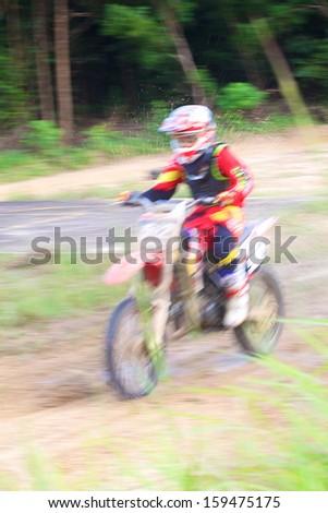 off-rod motobike riding, speed blurred motion - stock photo