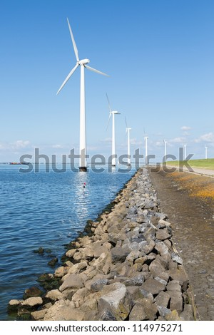 Off shore wind turbines in the Netherlands - stock photo