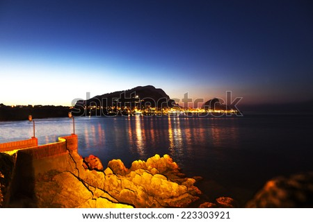 Off the coast of Sicily at nighttime. - stock photo