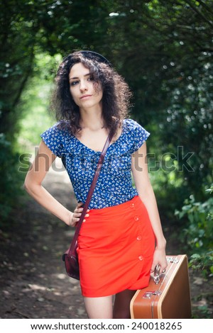 Off to elsewhere: young woman thinking about her next destination - stock photo