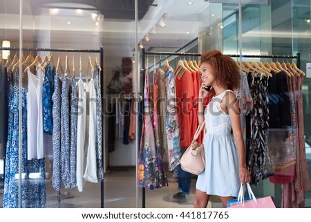 Off to the next sale at the shopping mall - stock photo