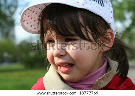 Offended and crying little girl in the park