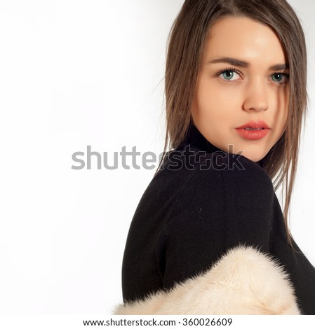 offended girl looking over her shoulder. Closeup portrait of grumpy, offended, childish, sad, shy, unhappy young woman, student, worker, employee, avoiding eye contact,  - stock photo