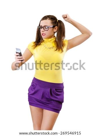 Offended girl-teenager with phone, isolated on white background. - stock photo