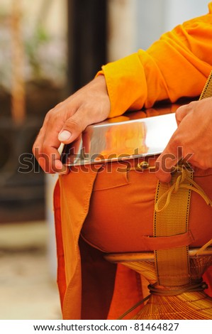 Offer food to monk on early morning - stock photo