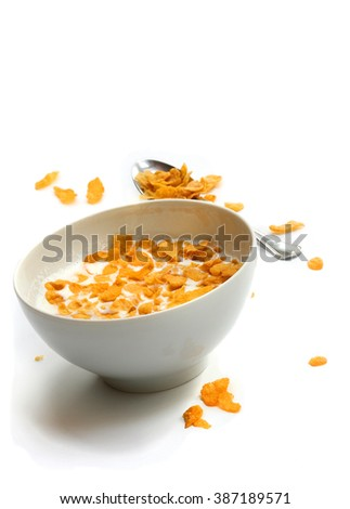 offering gluten-free breakfast-bowl of cornflakes with milk. - stock photo