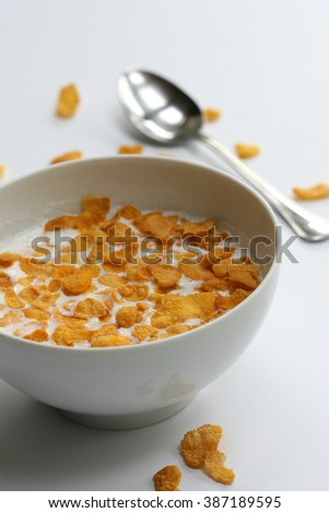 offering gluten-free breakfast-bowl of cornflakes with milk.