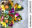 Offerings to gods in Bali with flowers, food and aroma sticks - stock
