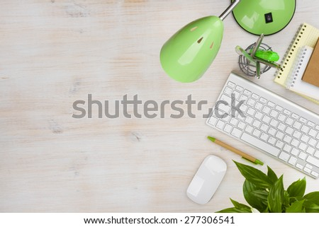 Office accessories over working desk with copyspace - stock photo