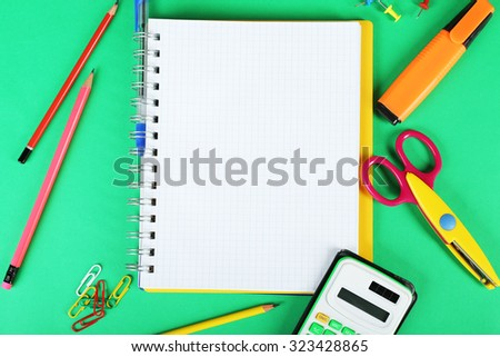 Office and student tools on green background closeup - stock photo