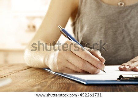 office and woman with pen