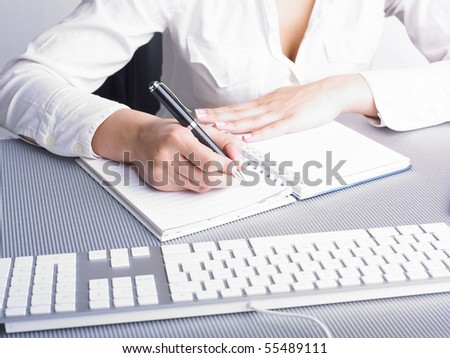 Office Assistant in white writing Schedule