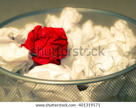 Office basket full creasy paper, red color - stock photo