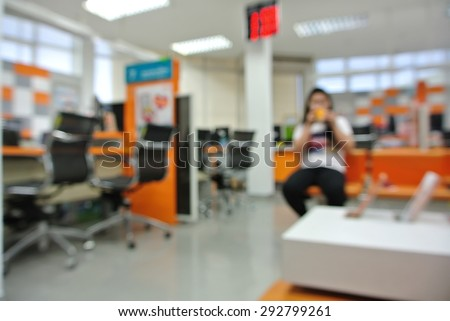 Office blur background with wooden desk and modern chair - stock photo