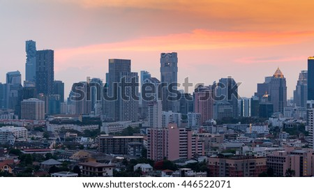 Office building and city downtown with sunset sky background