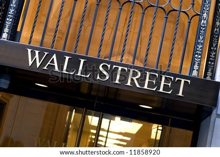 Office building entrance on Wall street in New York city - stock photo