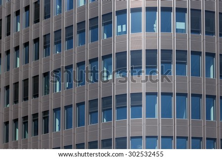 office building facade, windows of a skyscraper / bank / business building - stock photo