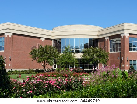 Office building facade with a neat landscaping - stock photo