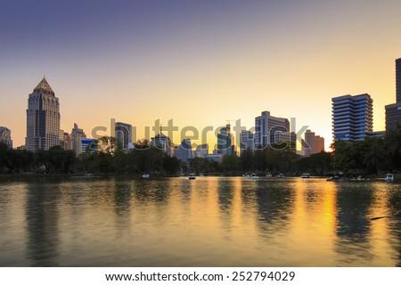Office building in Bangkok City at sunset (Lumphini Park) - stock photo