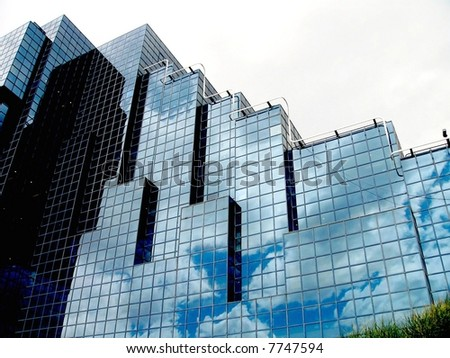 office building in London with reflection of clouds - stock photo