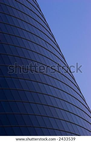 Office building in the evening. Skyscraper windows - stock photo
