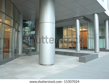 Office building lobby with glass windows and columns - stock photo