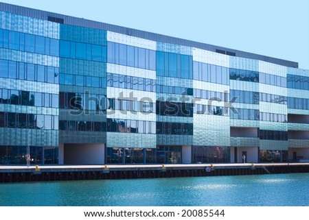 Office Building near water - stock photo