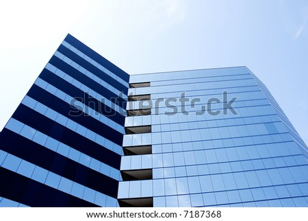 Office Building on a blue sky background - stock photo
