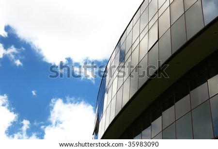 Office building on the blue sky background with clouds