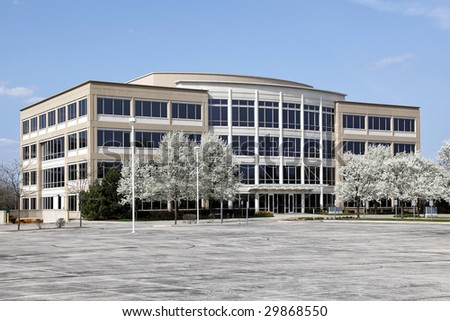 Office building with blooming trees in spring - stock photo