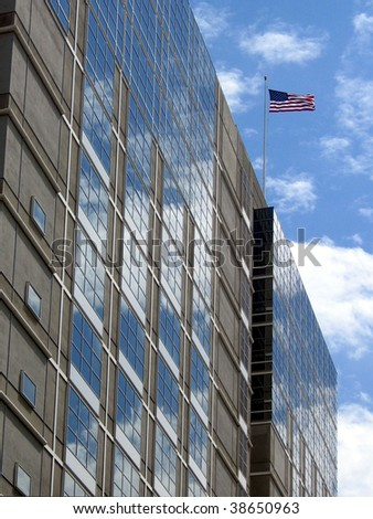 Office building with flag - stock photo