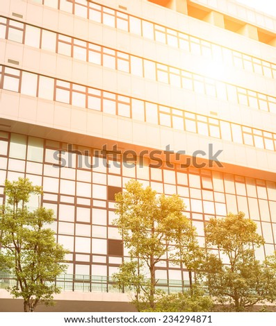 Office building with glass windows and sunshine - stock photo