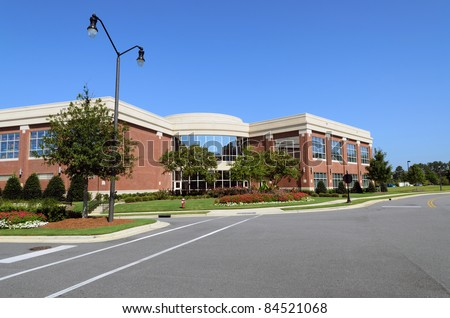 Office building with pedestrian crosswalk - stock photo