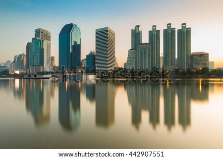 Office building with water reflection in central business park of Thailand