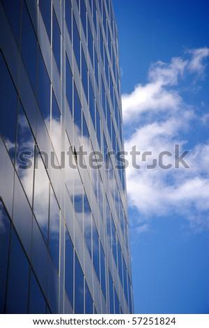 Office buildings against a clear blue sky - stock photo
