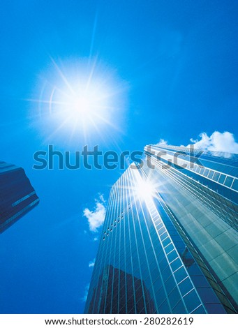 office buildings against blue sky - stock photo