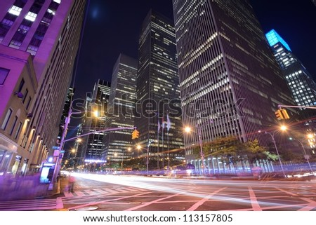 Office buildings at night along 6th Avenue in New York City. - stock photo