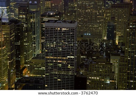 Office buildings at night in New York City. - stock photo