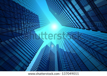 Office buildings on a background of the blue sky and solar flare - stock photo