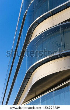 Office buildings with modern corporate architecture - business and success concept, blue sky, windows - stock photo