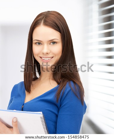 office, buisness, education concept - happy woman with big notepad - stock photo