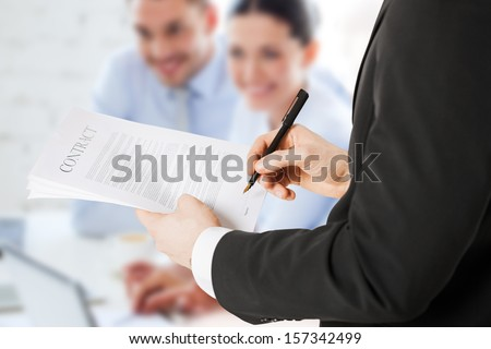 office, buisness, legal, teamwork concept - man signing contract - stock photo