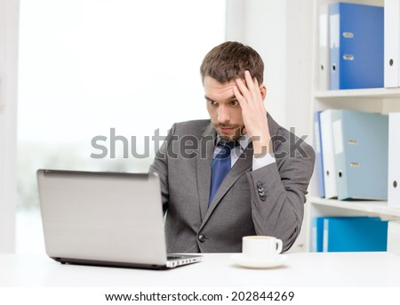 office, business, technology and internet concept - busy businessman with laptop computer and coffee at office - stock photo