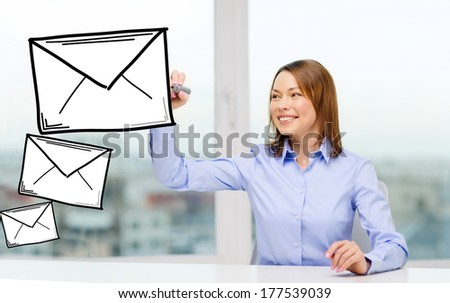 office, business, technology concept - businesswoman drawing envelope on virtual screen - stock photo
