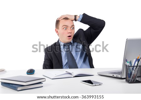 Office, business, technology, finances and internet concept - Shocked businessman with laptop computer and documents at office isolated on white background